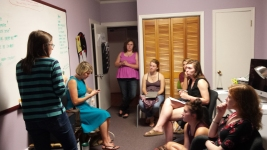 Editors meet before the open house to discuss the next issue.