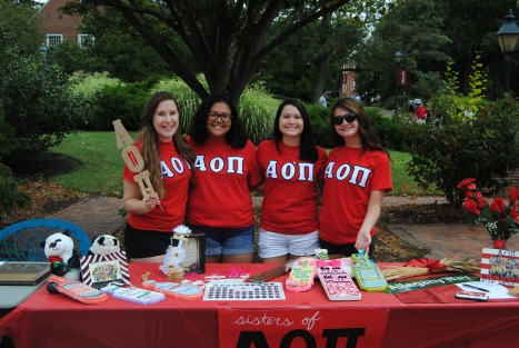 Members of AOII hang out at Club Fair