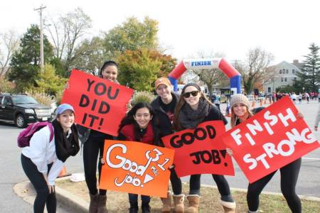 Sisters of AOII cheer on the runners